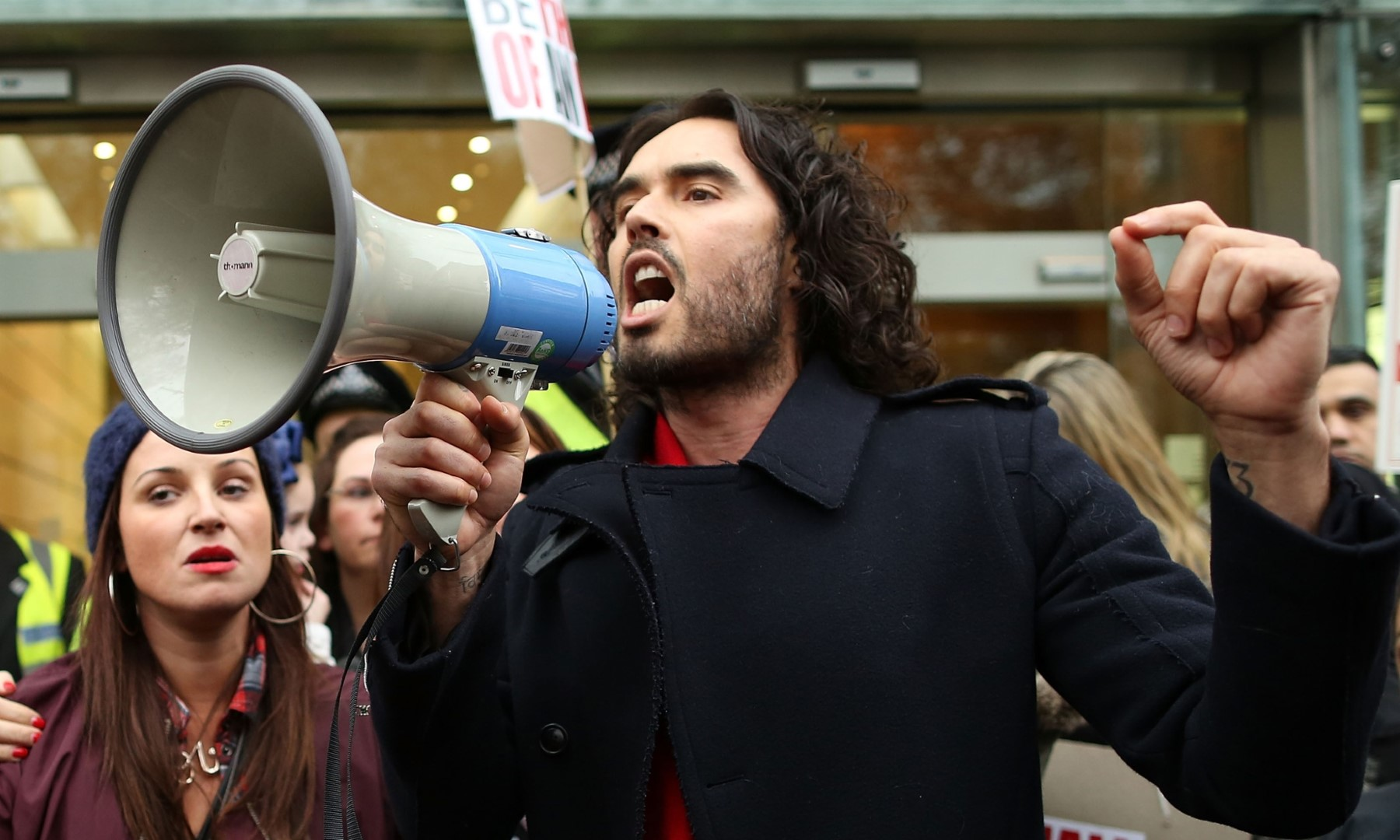 LONDON, ENGLAND - DECEMBER 01: Comedian Russell Brand joins residents and supporters from the New Era housing estate in East London as they demonstrate against US investment company Westbrook's plans to evict 93 families on December 1, 2014 in London, England. The protestors have taken their demonstration to Westbrooks Headquarters in Mayfair and plan to present a petition to the Prime Minister. WestBrook's are said to be planning to evict the tenants, refurbish the estate and re-let the flats at full market value. (Photo by Dan Kitwood/Getty Images)