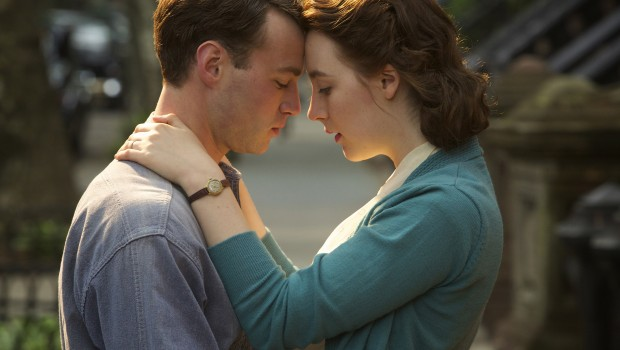 """Emory Cohen as """"Tony"""" and Saoirse Ronan as """"Eilis"""" in BROOKLYN. Photo by Kerry Brown.  © 2015 Twentieth Century Fox Film Corporation All Rights Reserved"""