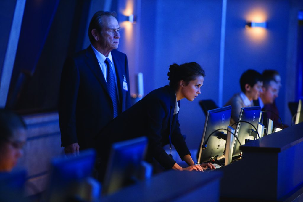 "CIA Director Dewey (TOMMY LEE JONES) and Heather Lee (ALICIA VIKANDER) in ""Jason Bourne,"" the action-thriller in which Matt Damon returns to his most iconic role. Paul Greengrass, the director of The Bourne Supremacy and The Bourne Ultimatum, once again joins Damon for the next chapter of Universal Pictures' Bourne franchise, which finds the CIA's most lethal former operative drawn out of the shadows."